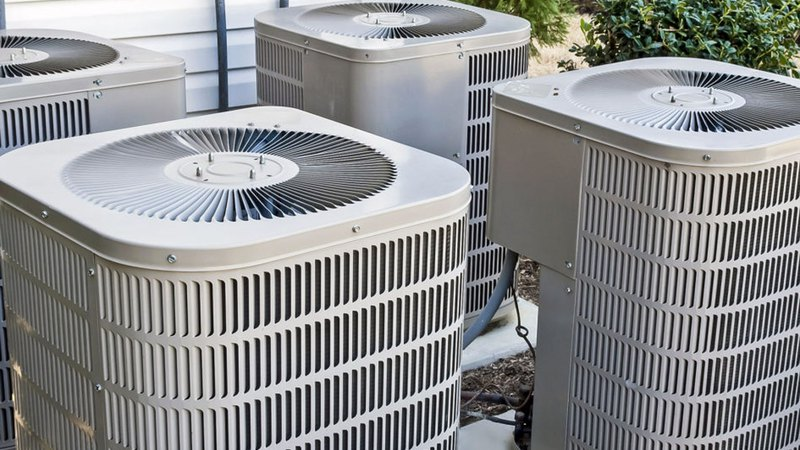 four outside AC units in need of professional air conditioning service