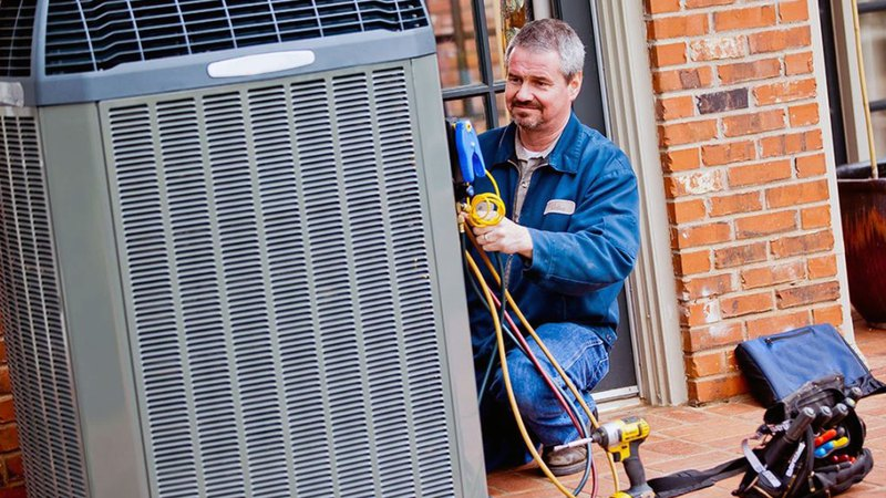 air conditioning service master fixing an outside air conditioning unit