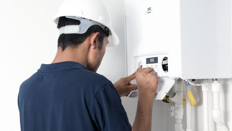 water heater service expert adjusting water heater before it can be used
